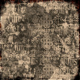 Grungy Text Background. Artistic grungy background with ancient text and symbols for scrapbooking and design Royalty Free Stock Photography