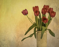 Grungy Textured Vase of Deep Pink Tulips in a Rustic Vase. A grungy, textured, rustic vase of dark pink tulips Placed on one side leaving white plenty of copy Stock Photo