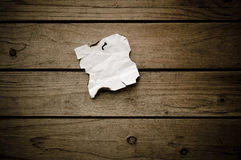 Grungy torn note paper nailed on wood Royalty Free Stock Photography