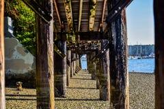 Grungy boardwalk framing beautiful marina royalty free stock photography