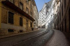Grungy urban street with curved road royalty free stock image