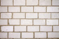 Grungy urban really white brick wall stock images