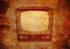 Grungy vintage background with TV and books Stock Photography