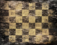 Grungy vintage chessboard Royalty Free Stock Image