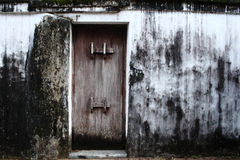 Grungy wall. Old fashioned door in a grungy wall Stock Photo
