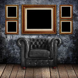 Grungy wall with Classic Brown leather armchair and old wood Royalty Free Stock Photography