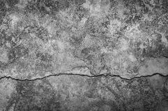 Grungy wall with large crack cement floor texture. Cement large crack for dark background royalty free stock image