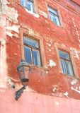 Grungy old weathered facade with old lantern Stock Image