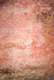 Grungy wall texture. In shades of red and orange Stock Photography