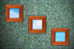 Grungy wall with three wooden frames Royalty Free Stock Photos