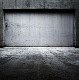 Grungy wall with tough and heavy steel door. Royalty Free Stock Photo