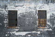Grungy wall with two windows Stock Photo