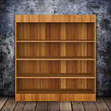 Grungy wall with Wooden book Shelf and Old wood. Royalty Free Stock Image