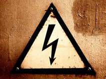 Grungy warning sign Stock Photo