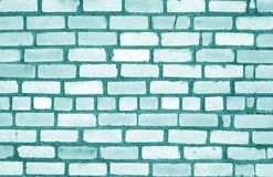 Grungy weahered brick wall in cyan tone. Abstract background and texture for design royalty free stock photo