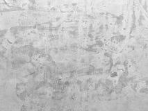 Grungy weißer Betonmauerhintergrund Lizenzfreie Stockbilder