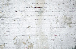 Grungy White Brick Wall Background. Closeup of grunge painted white brick wall background. Photographed June 28th 2014 Royalty Free Stock Image