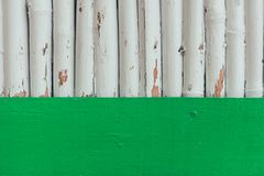 Grungy wooden logs painted in white. For background stock photos