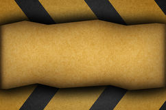 A grungy and worn hazard stripes background Stock Photography