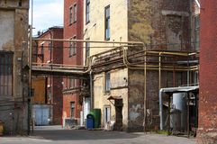 Grungy yard of a small factory in Russia Stock Images