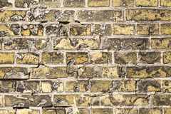 Grungy yellow brick wall for backgrounds Royalty Free Stock Photo