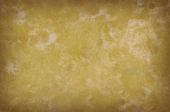 Grungy yellow mottled background texture Stock Photography