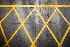 Grungy yellow road paint pattern Stock Images
