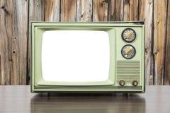 Grungy Zielona rocznik telewizja z drewno ścianą i Ciie Out piarg Zdjęcia Royalty Free