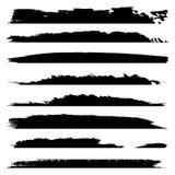 Grungy zwarte verfhand - de gemaakte creatieve reeks van de borstelslag stock illustratie