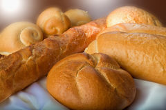 Group of bread. Different kinds of bread on a tablecloth Royalty Free Stock Images