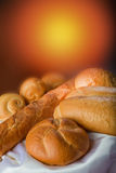 Group of bread (vertical). Different kinds of bread on a tablecloth Royalty Free Stock Photo