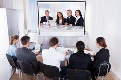 Grupa biznesmeni w wideokonferencja obraz stock
