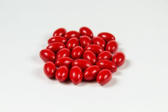Grupa czerwone miękkie gelatine kapsuły Obraz Stock