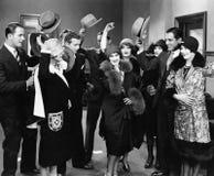 Grupa ludzi bierze kapelusze daleko kobieta (Wszystkie persons przedstawiający no są długiego utrzymania i żadny nieruchomość ist Obrazy Stock