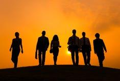 Grupa ludzie biznesu Chodzi w plecy Zaświecającym Fotografia Stock