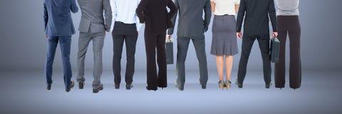 Grupa ludzie biznesu stoi z błękitnym winiety tłem Obrazy Stock