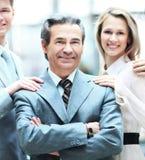 Grupa ludzie biznesu z biznesmena liderem na przedpolu fotografia stock