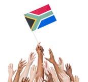 Grupa ręki Dosięga Południowa Afryka flaga Fotografia Stock