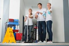 Grupa Szczęśliwy Młody Janitor Pokazuje aprobaty fotografia stock