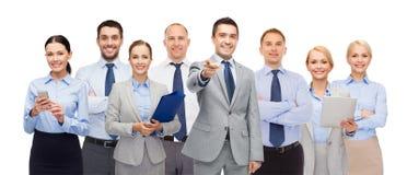Grupa szczęśliwi ludzie biznesu wskazuje przy tobą Obrazy Royalty Free