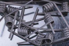 Grupa vaping zwitki dla elektronicznego papierosu, e vape lub cig przyrządów metalu tła i Zdjęcie Stock