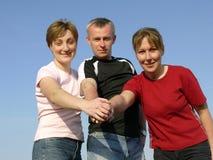 Grupo acertado de tres Imagen de archivo