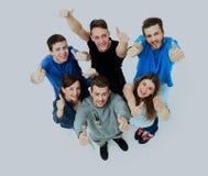 Grupo alegre feliz de amigos que animan aislado en el fondo blanco Fotografía de archivo