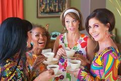 Grupo bonito de mulheres que Giggling imagem de stock