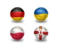 Grupo C do Euro bolas do futebol com as bandeiras nacionais de Alemanha, Ucrânia, poland, Irlanda do Norte ilustração do vetor