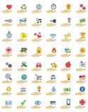 Grupo colorido do ícone de objetos sobre as mãos Fotos de Stock