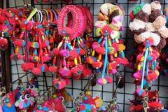 Grupo colorido do laço do cabelo na plaza Fotos de Stock Royalty Free