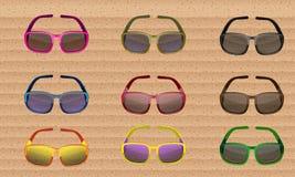 Grupo colorido dos óculos de sol Vetor Fotos de Stock Royalty Free