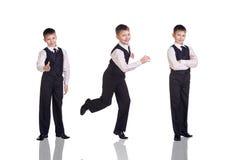 Grupo completo do comprimento de um menino no terno Imagem de Stock