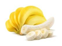 Grupo da banana e partes descascadas no branco Foto de Stock Royalty Free